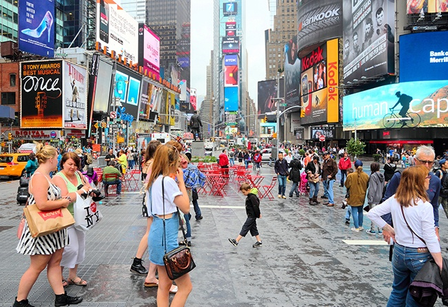 Times Square with ads and shoppers